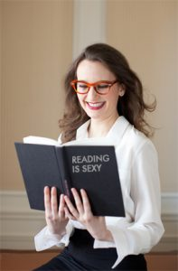 A woman reading a sexy book.