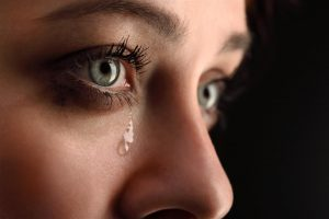 A listener, weeping.